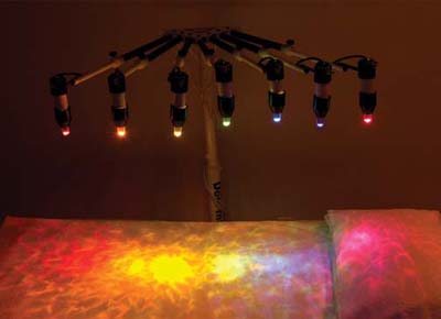 Crystal Light Healing bed with colored lights turned on